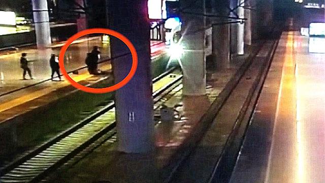 监拍:女子为吓唬男友 列车进站时跳下站台逼停高铁