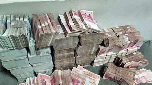 会计侵占1600万买8套房 用麻袋装百万现金埋进山里