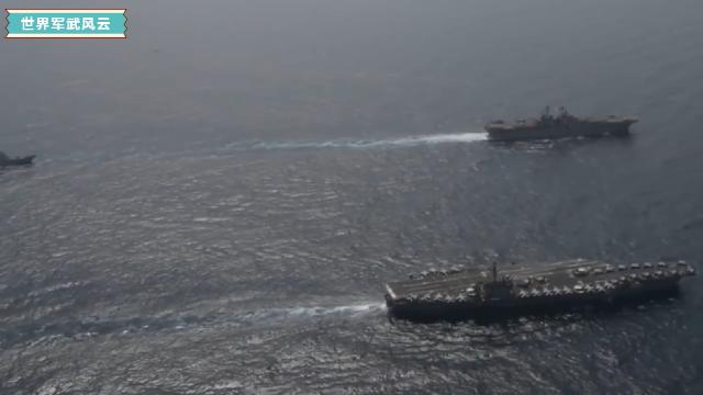 直升机航拍美国海军航空母舰进入波斯湾