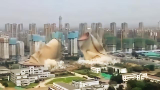 轰!唐山西郊两座92米高冷却塔成功爆破
