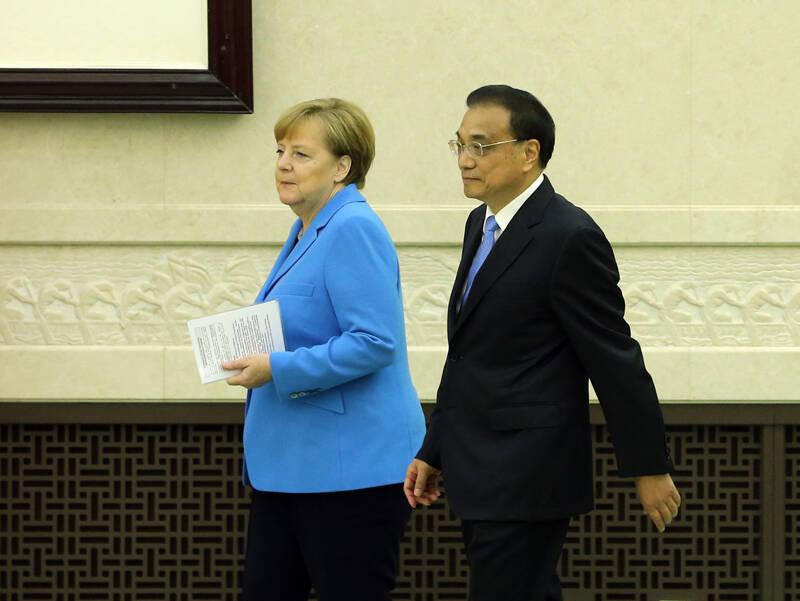 李克强与默克尔一致表示: 共同推进中欧投资协定谈判