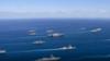 卫星确认美军航母进入南海 一天之内已有7架美军机在南海活动