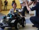 暖心创意 儿童医院用遥控小轿车把患儿送进手术室