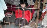 贵州一女子被关树林里的铁笼10年