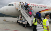 昆明机场一误机乘客谎称机上有炸弹 致飞机返航丨组图