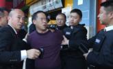 法官强制腾房 无关男子起哄被拘15天
