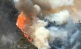 四川山火焚烧超75小时 1500人灭火