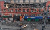 北京一大厦大面积坍塌 多辆汽车被砸