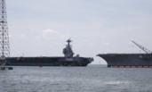 双航母同框:美军福特号返厂维护 遇上企业号残躯