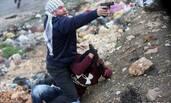 以色列卧底警察对空开枪 抓走蒙面抗议者
