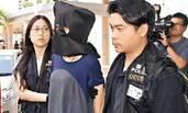 打付国豪的女子被拘