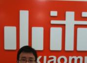 雷军晒小米刚创办时前台照片:7年前小米Logo竟是这样