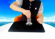视频:刘谦春晚魔术揭秘 硬币穿进杯子