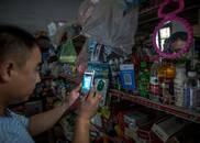 中国农村迅速拥抱移动支付:四岁孩子都会扫二维码买零食