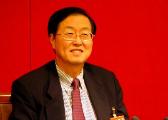 央行行长周小川:扩大汇率浮动区间不是当前关注重点