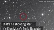 天文学家用望远镜看到一辆跑车在太空漂浮