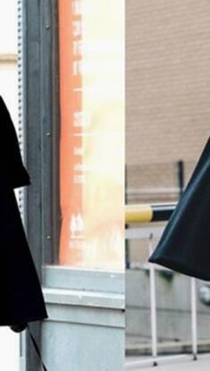 撑面子扮时髦 一件黑色斗篷绝对最有效