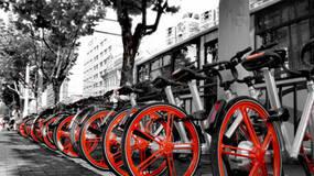 """前轮公益,后轮盈利:""""网约自行车""""背后的政企博弈"""