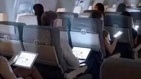 大快人心,马上我们就可以在飞机上玩手机了