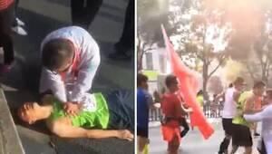 马拉松选手两次晕倒 复苏后扔要完赛