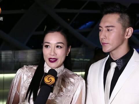 钟丽缇夫妇亮相北京凤凰中心 为好友时装秀造势