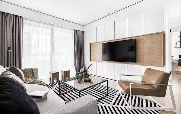 电视背景墙设计的很有线条感,块状的背景墙好似拼接而成的,黑白条纹的