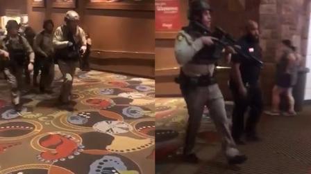 警察荷枪实弹抵达枪击现场 有人用中文喊加油