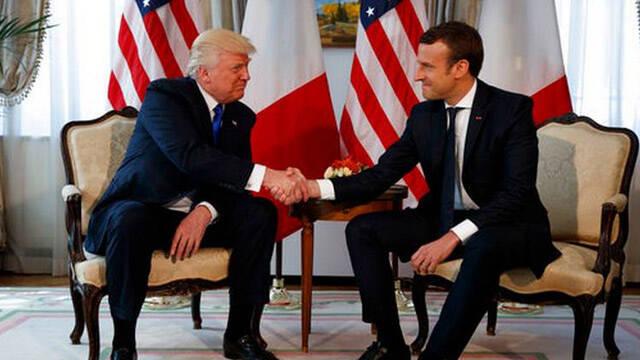 棋逢对手!马克龙式握手似乎让特朗普吃不消