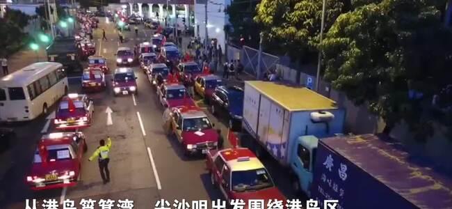 反对暴力回归法治!香港500辆出租车挂上国旗游街
