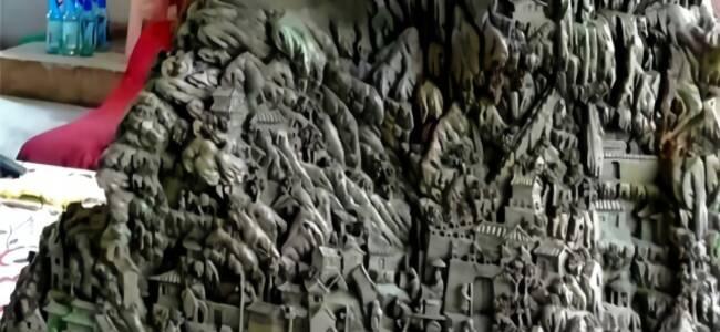七旬老人在千年奇楠木上雕出《万里江山图》
