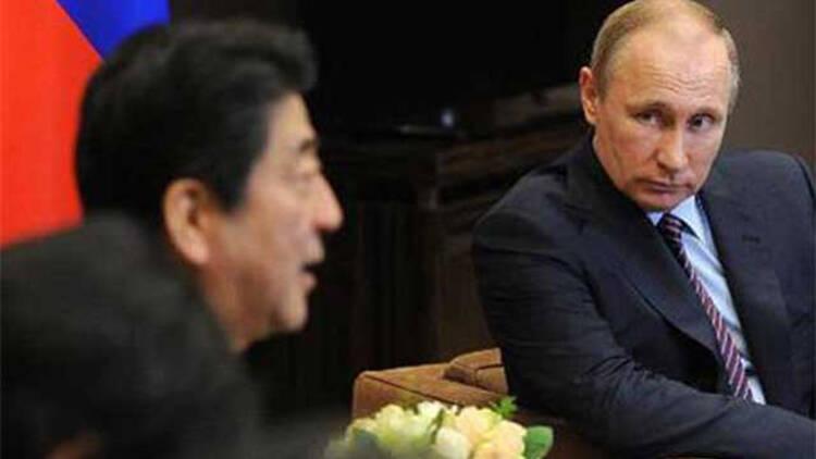 普京会晤安倍商讨朝核问题 促各方保持克制