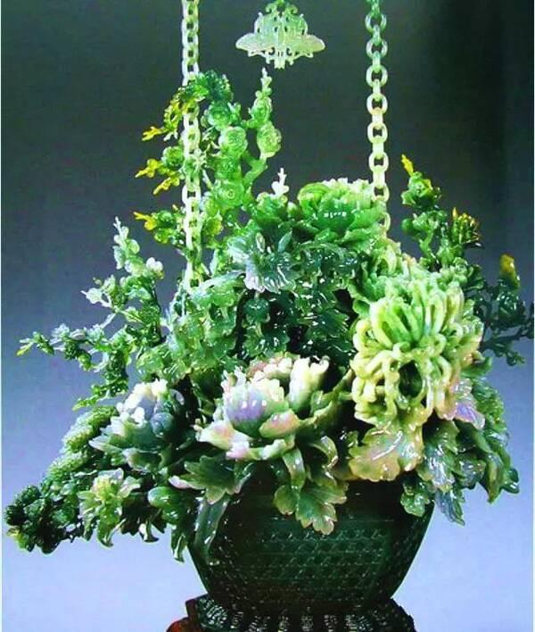第1插菊综合网_篮高64厘米,其中满插牡丹,菊花,月季,山茶等四季香花,是当今世界最高